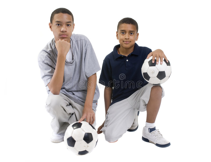 Soccer Players. Two african american brothers with soccer balls. teamwork stock photos