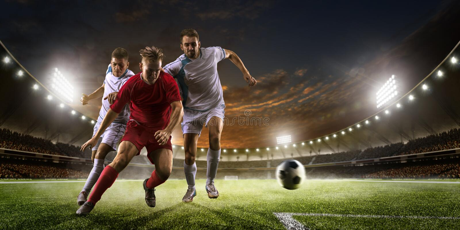Soccer players in action on sunset stadium background panorama stock photos