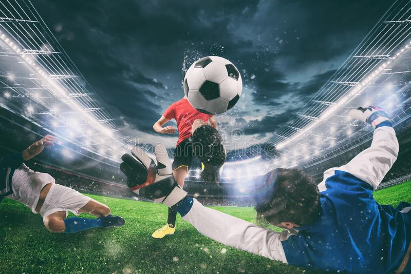 Close up of a football action scene with competing soccer players at the stadium during a night match royalty free stock photos