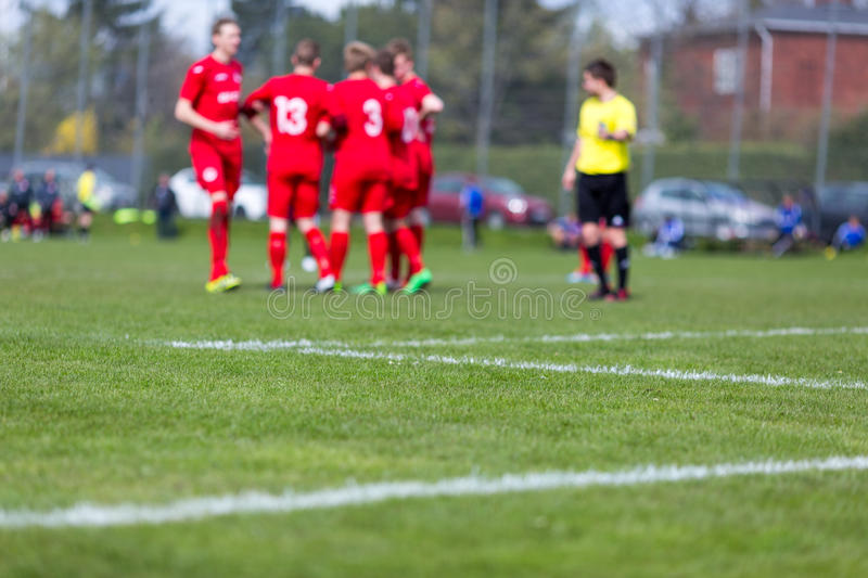 Soccer players and referee stock photos