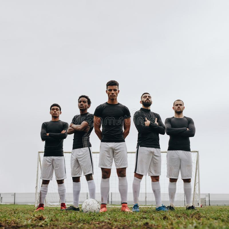 Soccer players standing on the field during practice stock images