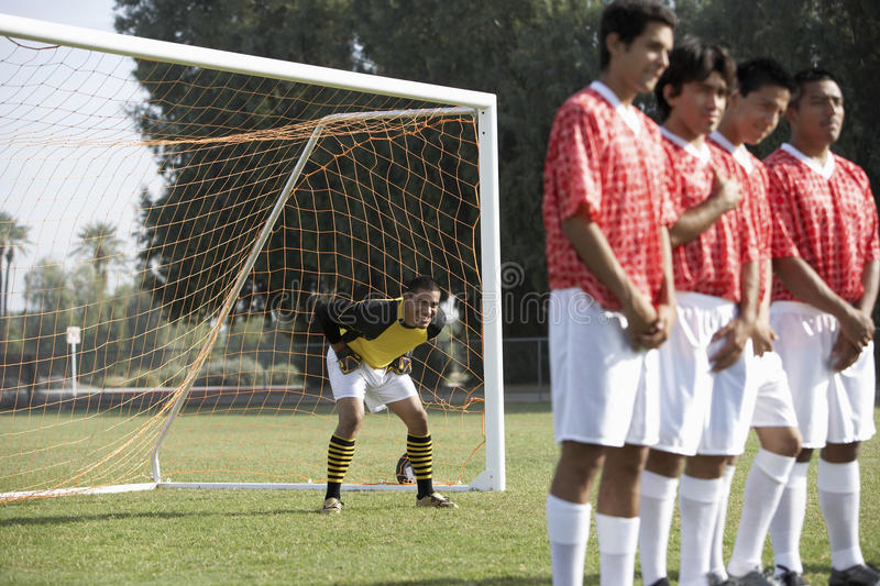 Soccer Players Standing In A Row Preparing For Free Kick stock photography