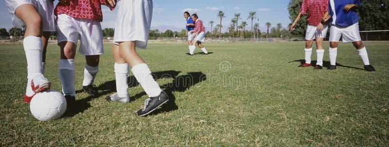 Soccer Players Tackling Football. Rival female soccer players tackling football royalty free stock photos