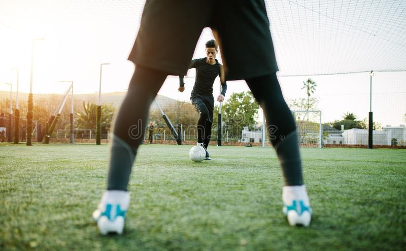 Soccer players during team practice royalty free stock image