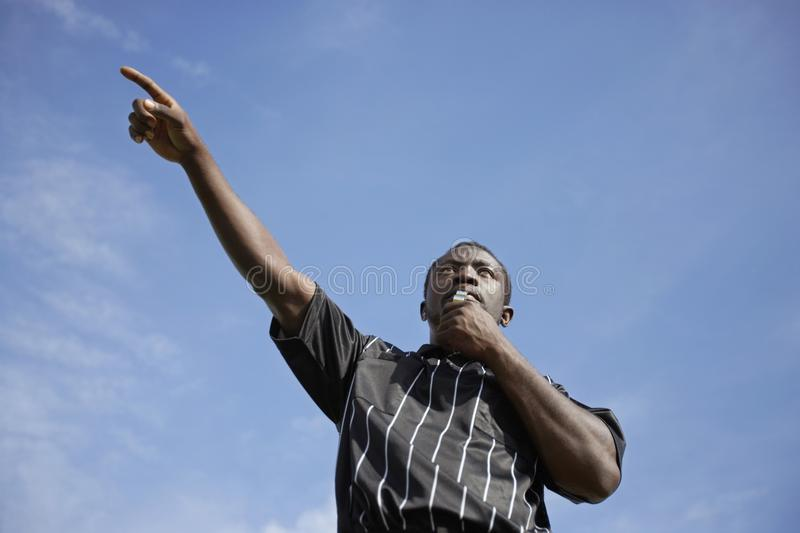 Download Soccer Referee Blowing Whistle And Pointing, Portr Royalty Free Stock Images - Image: 13585089