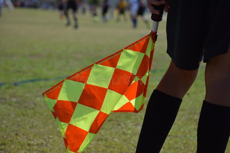 Soccer Referee Line Judge Holding Checkered Flag stock photo