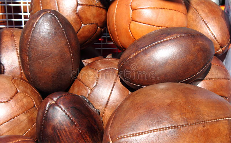 Soccer and rugby balls stock photos