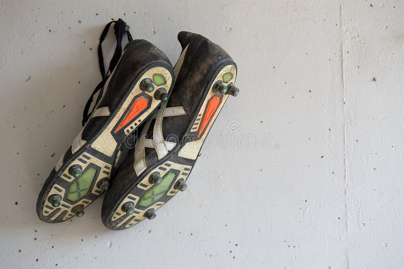 Soccer shoes. On the wall stock images