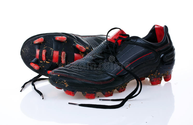 Soccer shoes. A pair of used soccer shoes royalty free stock photography