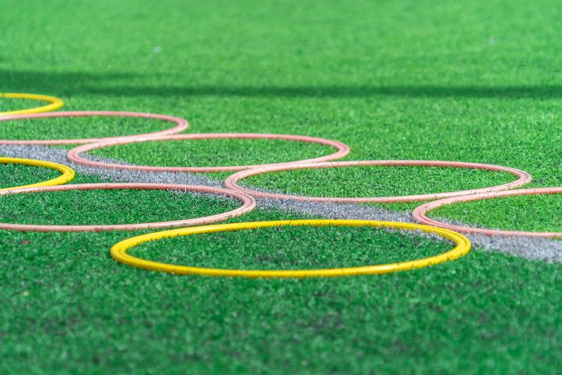 Soccer sport training on green outdoor soccer training field. Soccer sport training equipments on green outdoor soccer training field royalty free stock image