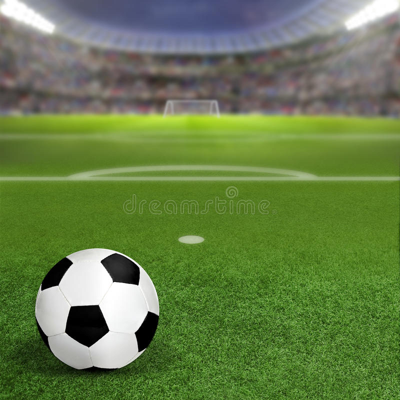 Soccer Stadium With Ball on Field and Copy Space. Soccer stadium full of fans in the stands with soccer ball on the field inside the penalty box. Deliberate royalty free stock photography