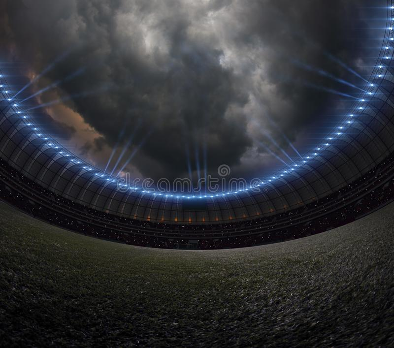 Soccer stadium with illumination, green grass night sky royalty free stock photography