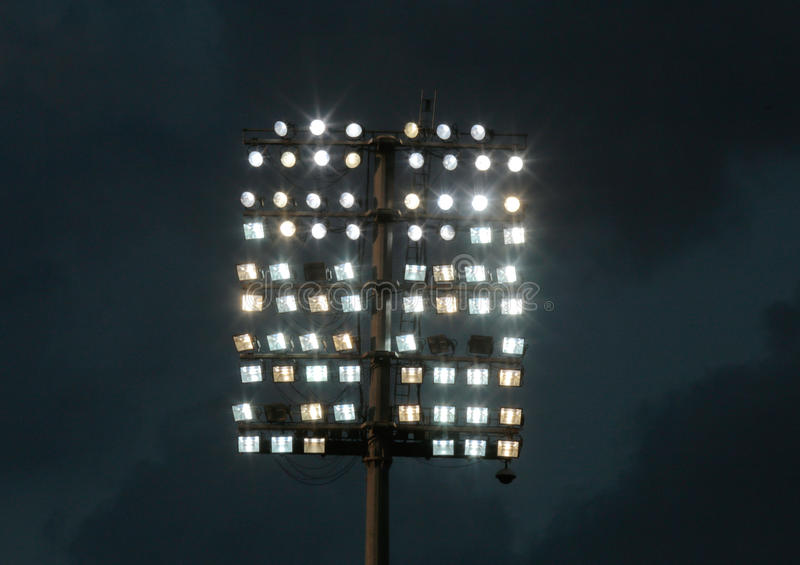 Soccer stadium lights stock photography