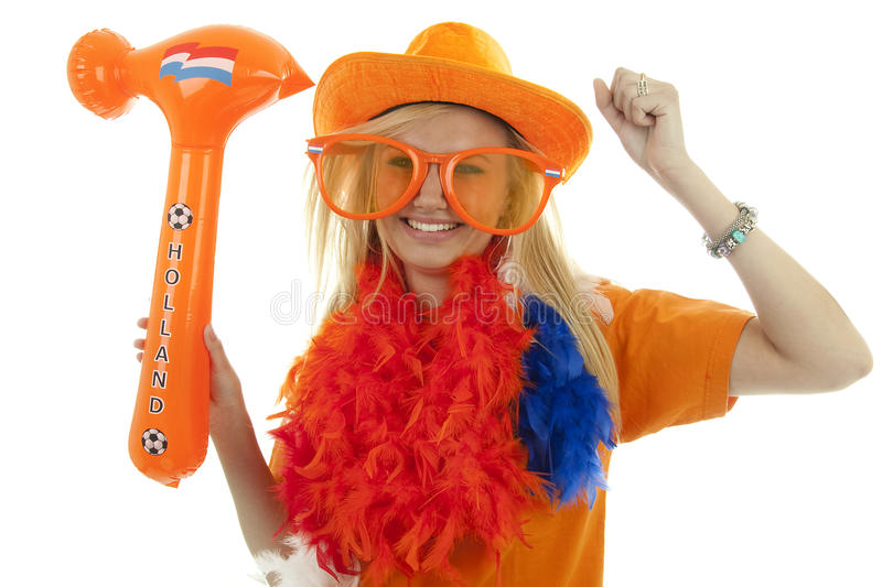 Soccer supporter with blown up hammer. Soccer supporter in orange outfit with blown up hammer over white background stock images