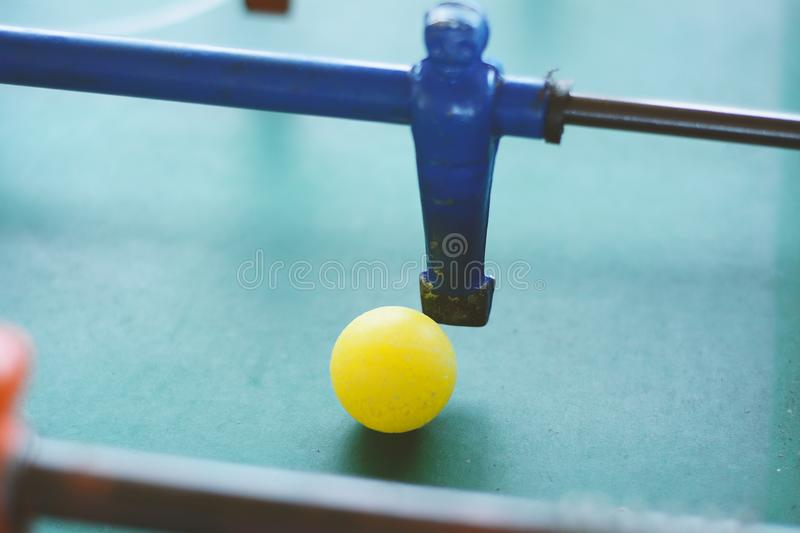 Soccer table game, blue foosball player. royalty free stock photography