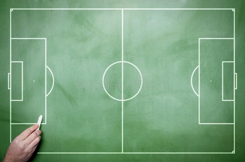 Soccer tactics. On the blackboard stock photography