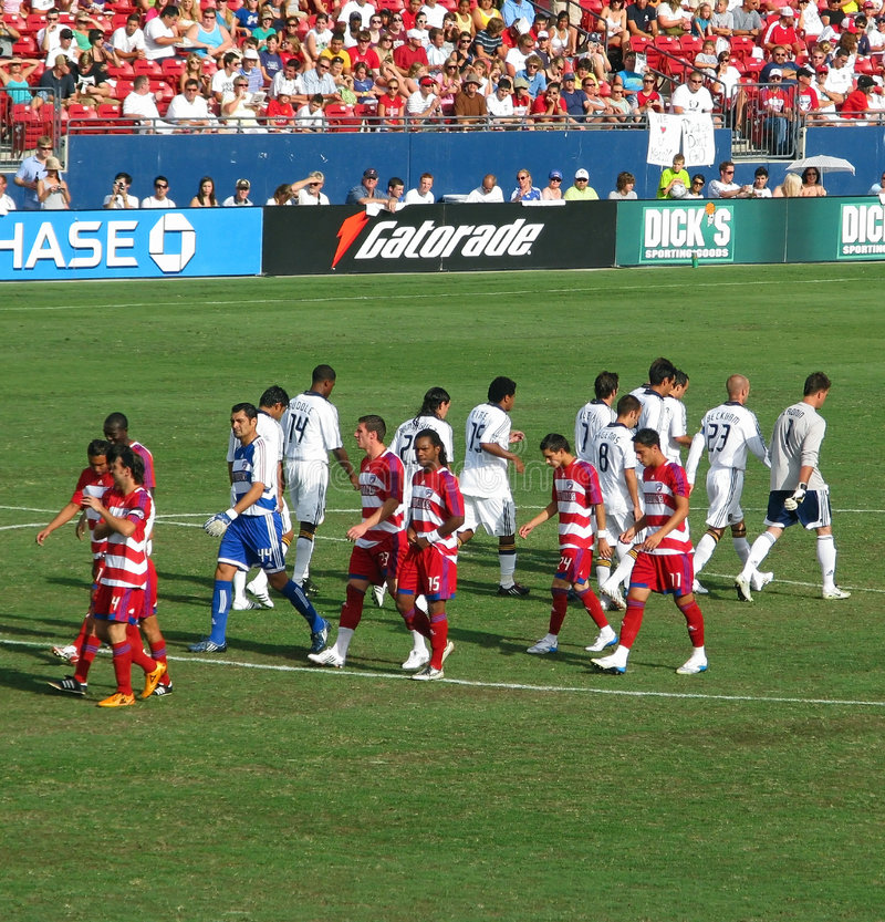 Soccer Teams. The FC Dallas Hoops and LA Galaxy soccer teams take their postion at the start of the game on July, 27, 2008 in Frisco, Texas royalty free stock images