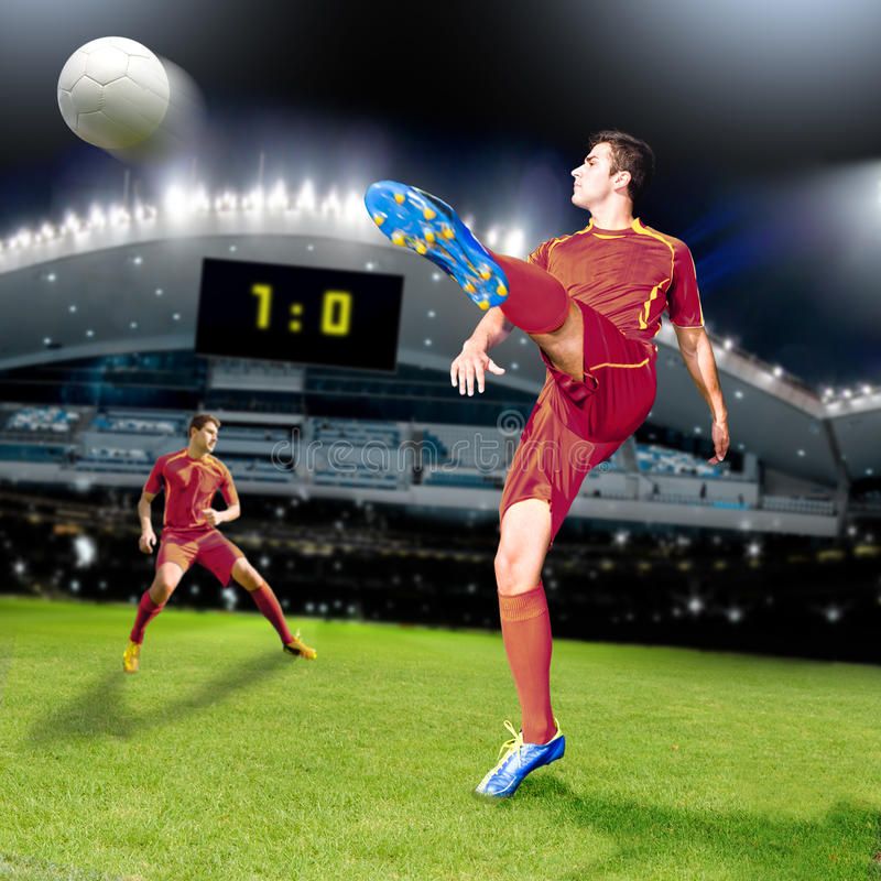 Soccer time. Soccer or football player on the field stock photo