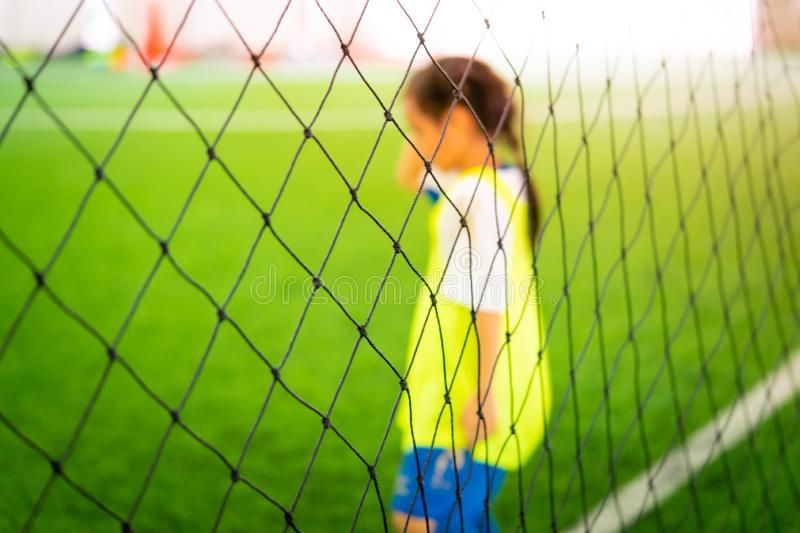 Soccer training blur on training ground with children. Soccer training net blur on training ground with children royalty free stock photography