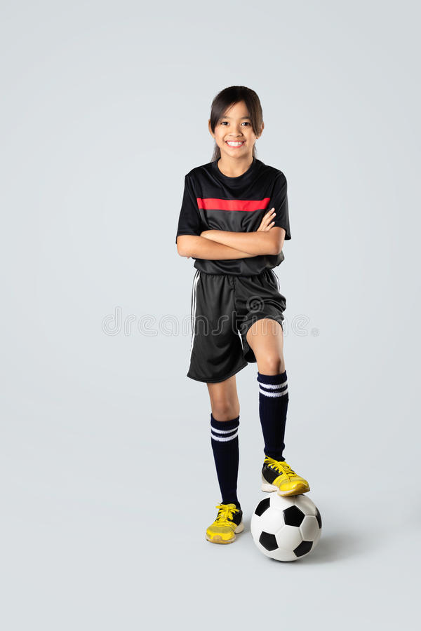 Soccer. Young asian girl playing soccer, over white stock images