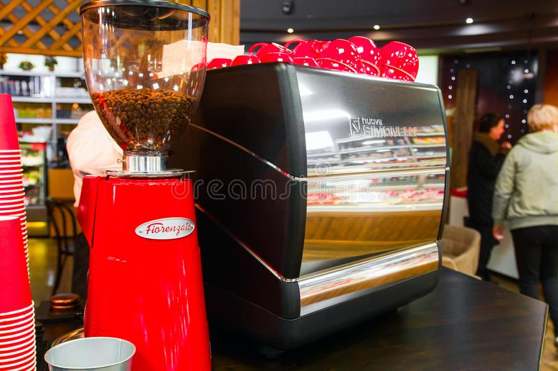 SOCHI,RUSSIA,  18 APRIL 2019 - close up of coffee machine and red cups  in the coffee shop stock photography