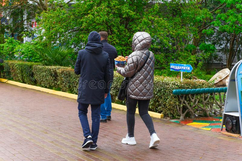 SOCHI,RUSSIA,  21 APRIL 2019 - couple of young tourists walking  in the Riviera park stock image