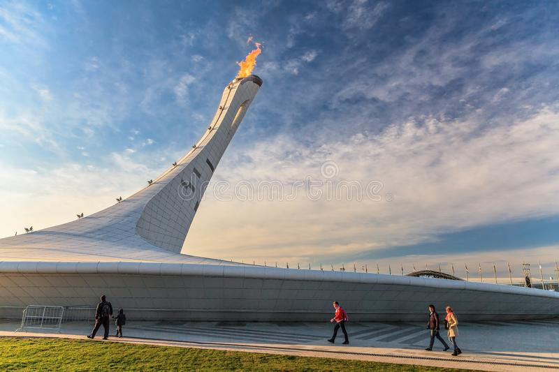 Big Olympic Torch erection with burning flame in Olympic Park was main venue of Sochi Winter Olympics in 2014. Beautiful scenic royalty free stock photo