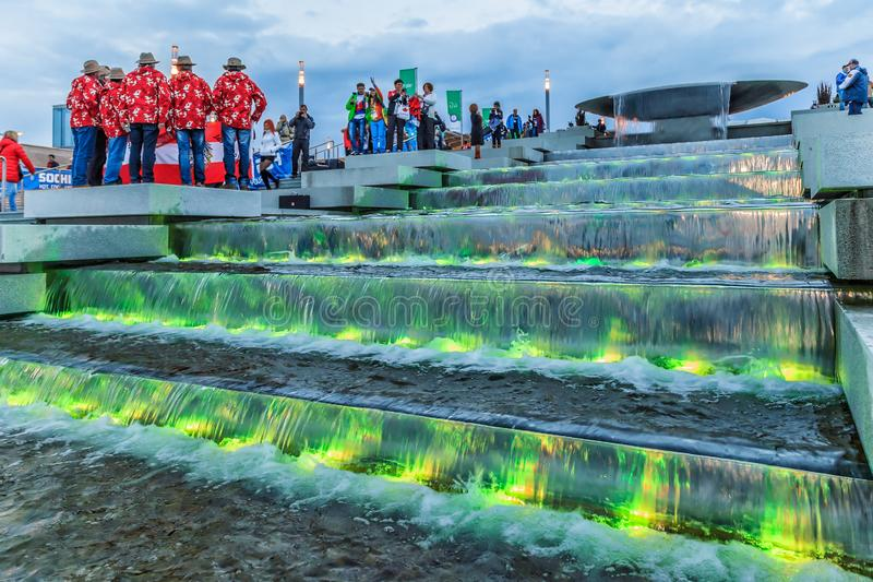 Illuminated waterfall fountain cascade by Olympic Park enchants with its beautiful play of. Sochi, Russia - February 10, 2014: Illuminated waterfall fountain royalty free stock images