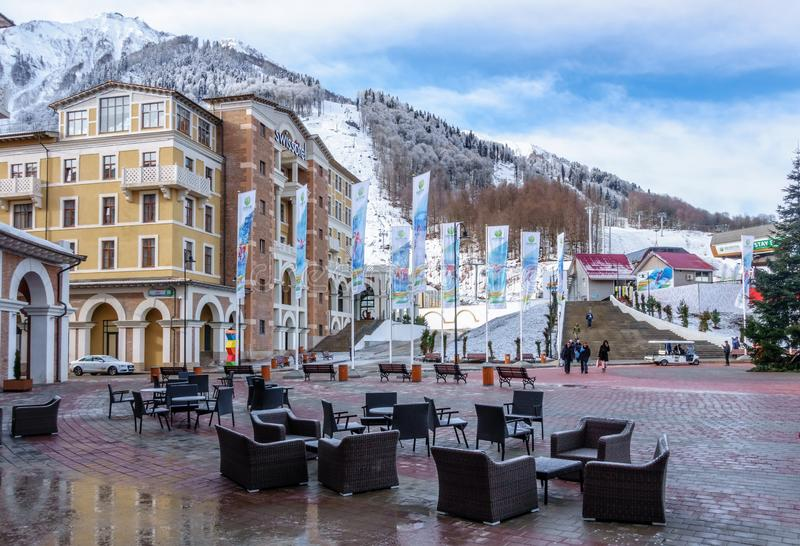Sochi, Russia - February 19, 2014: Modern hotels of Gorky Gorod mountain ski resort face beautiful winter mountain sceneries.  royalty free stock photo