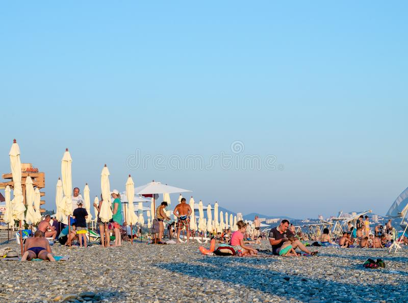 People on the beach in the evening. Sochi, Russia - July 7, 2019: People on the beach of Dagomys in the evening stock images