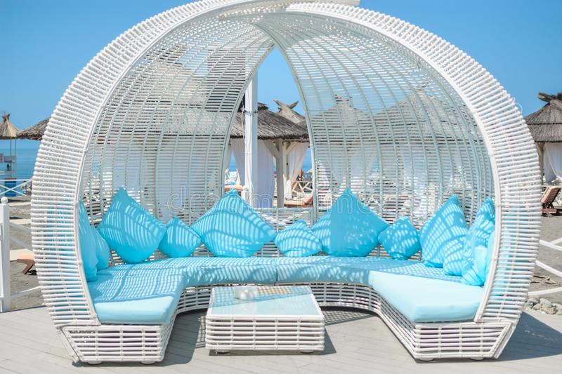 SOCHI, RUSSIA - 9 JUNE 2019: Beautiful white and blue interior design of arbors from the sun in the beach cafe Grapes royalty free stock image