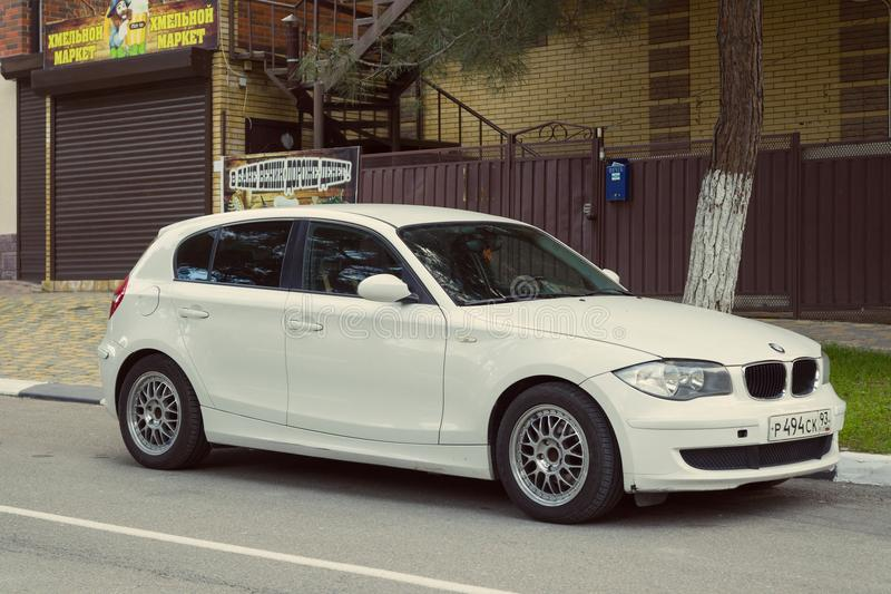 New luxury BMW 120 parked in street of the Sochi city. Sochi, Russia - November 26, 2017: New luxury BMW 120 parked in street of the Sochi city royalty free stock photography