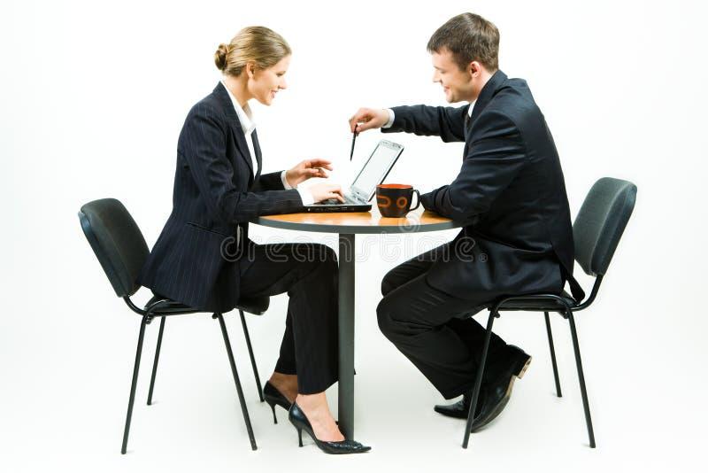 Soci commerciali sul lavoro immagini stock