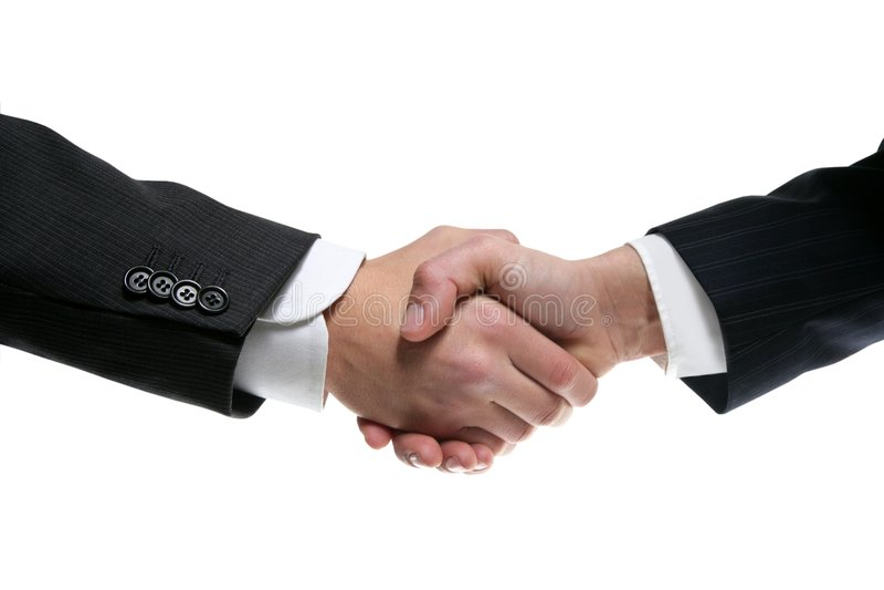 Soci dell'uomo d'affari che agitano le mani con il vestito fotografie stock libere da diritti