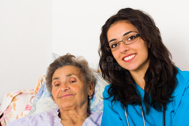 Social Care at Home. Social care nurse for elderly patients at home stock photography