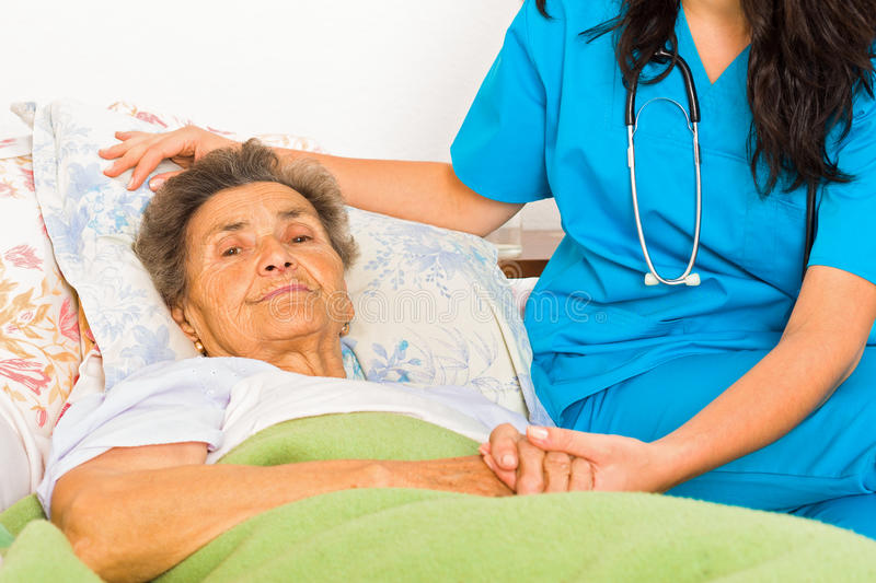 Social Care at Home. Social care nurse for elderly patients at home royalty free stock photos