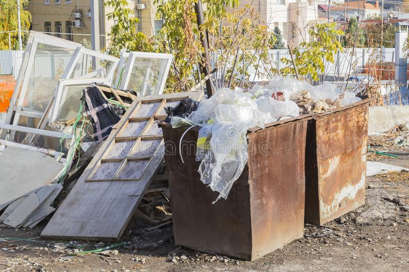 Social and communal problems. Failure of garbage. Crowded dumpster and dump. Old windows ejected. stock photography