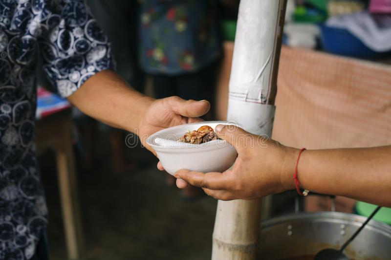 Social concept of poor people sharing : Concept serving free food to the poor : Free food, Using leftovers to feed the hungry :. Food concept of hope : The poor royalty free stock image
