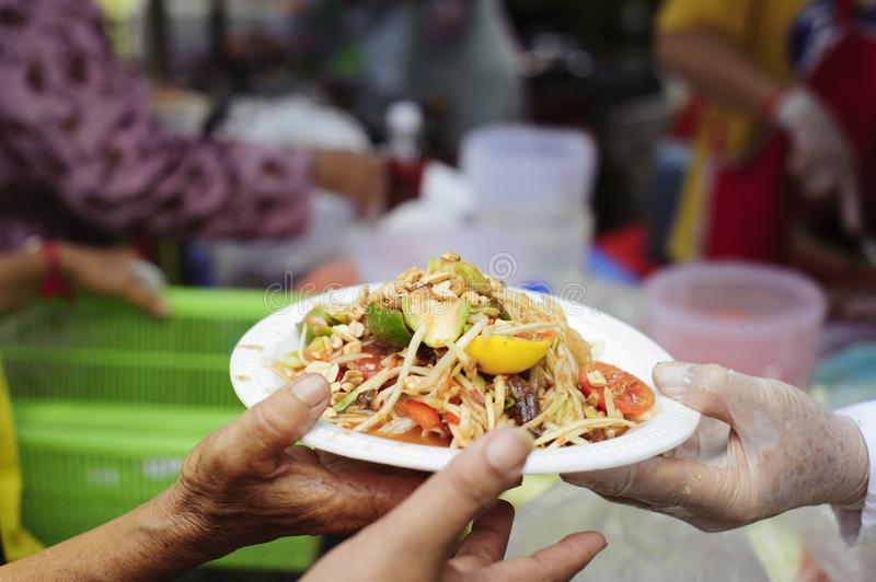 Social concept of poor people sharing : Concept serving free food to the poor : Free food, Using leftovers to feed the hungry :. Food concept of hope : The poor royalty free stock photography