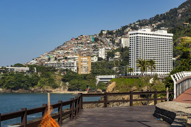 Social contrast. Vidigal district and luxury hotel, slum favela and sophisticated buildings in the South Zone of Rio de Janeiro. royalty free stock photo