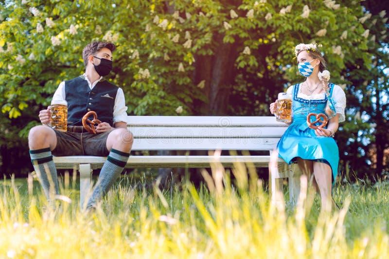 Social distancing in Bavaria at the beer garden stock photos