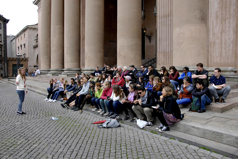 SOCIAL DUMPING IN TOURISM. COPENAHGEN /DENMARK 23 June 2015_ Social dumping in tourism foreign so called touris guard ask FREEN TOUR and after ask people for royalty free stock photography