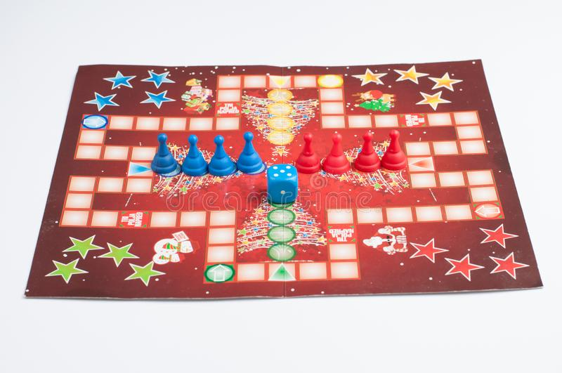 Social game.Blue and red figure.Blue dice and figure stock photos