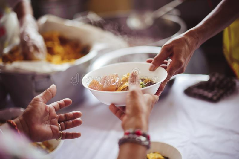 Social hunger: Volunteers provide food assistance to poor people who need food royalty free stock images