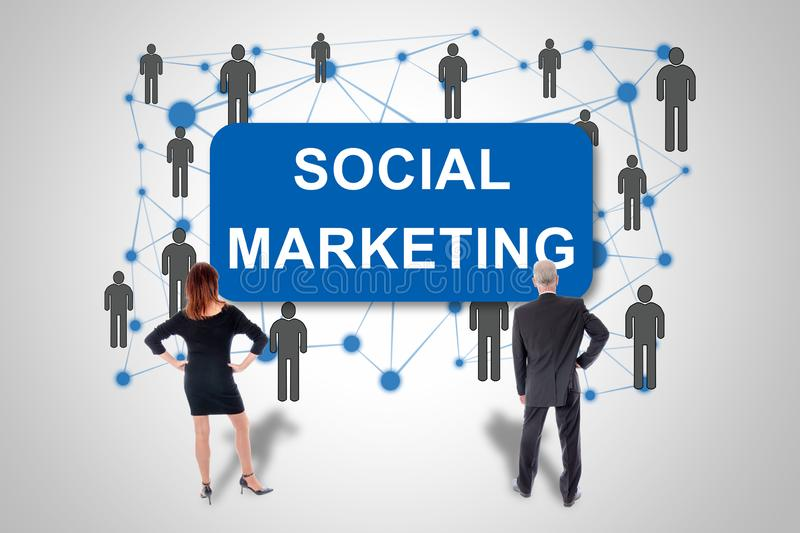 Social marketing concept watched by business people stock image