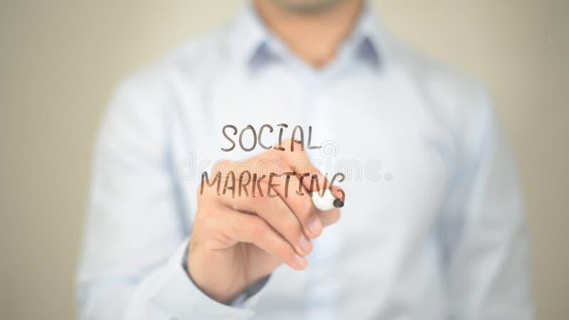 Social Marketing, Man Writing on Transparent Screen royalty free stock image