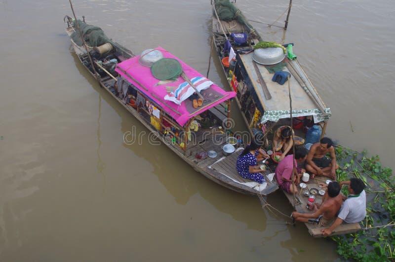 Social meal on Mekong delta stock photos