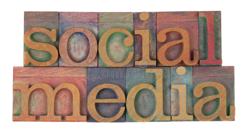 Social media. In vintage wooden letterpress printing blocks, stained by color inks, isolated on white