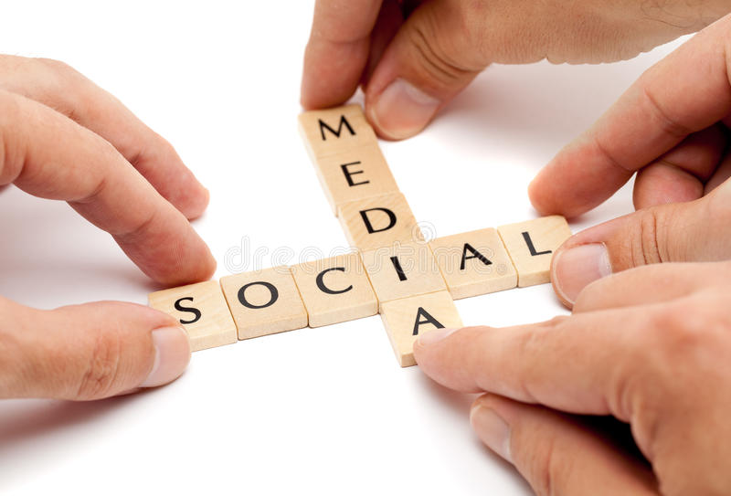 Social media. Hands forming the term social media from letters