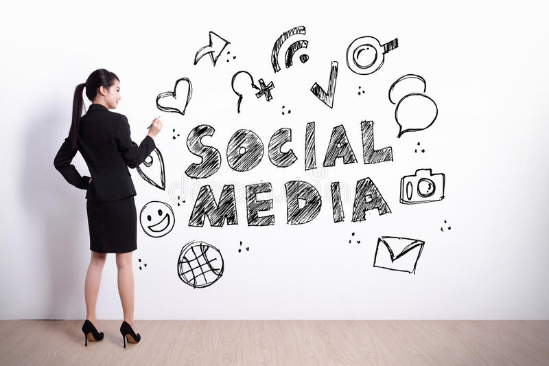 Social Media concept. Business woman write social media text and icon on the white wall background stock photos